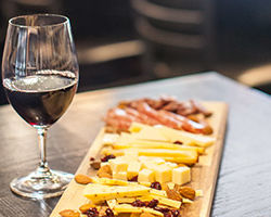 glass of wine and charcuterie