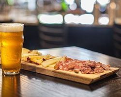 glass of beer and charcuterie plate