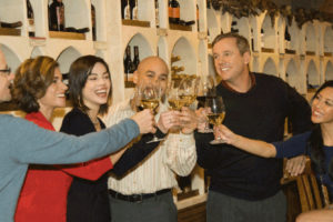 friends toasting at winestyles tasting station