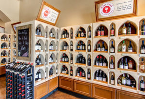 photo of wine bottles in alcove shelving