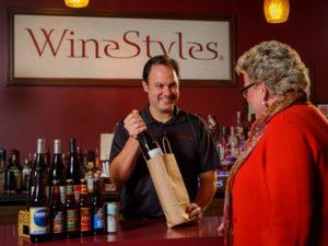 Arthur Lampros helping customer